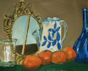 still life of oranges before a mirror
